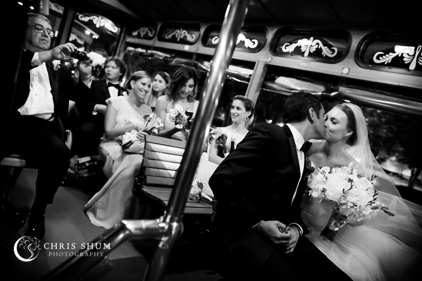 Destination-wedding-St-Pete-Florida-bride-and-groom-kissing-on-trolley