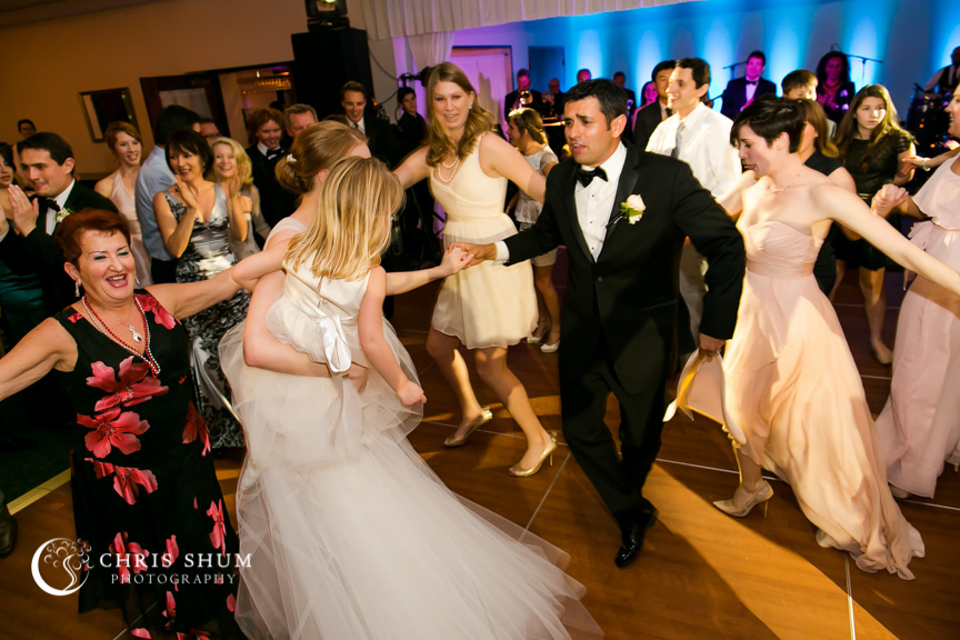 Destination-wedding-St-Pete-Florida-strong-bride-holding-child-dancing