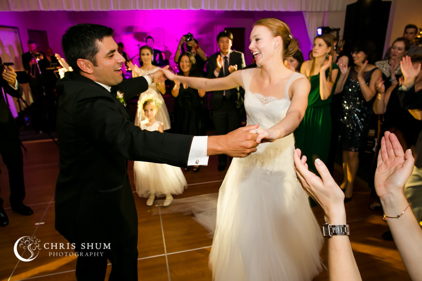 Destination-wedding-St-Pete-Florida-bride-groom-holding-hands-dancing