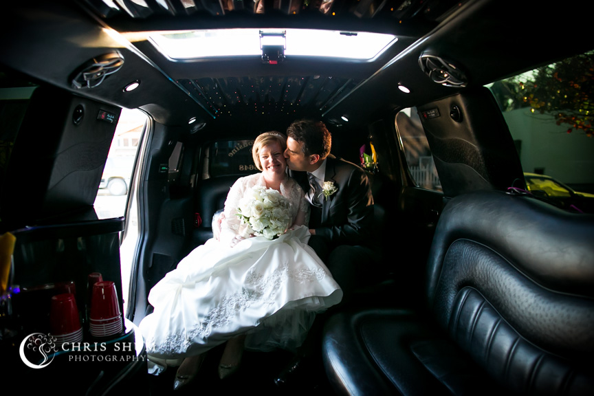 """San-Jose-Campbell-wedding-sweet-kiss-in-limo"""