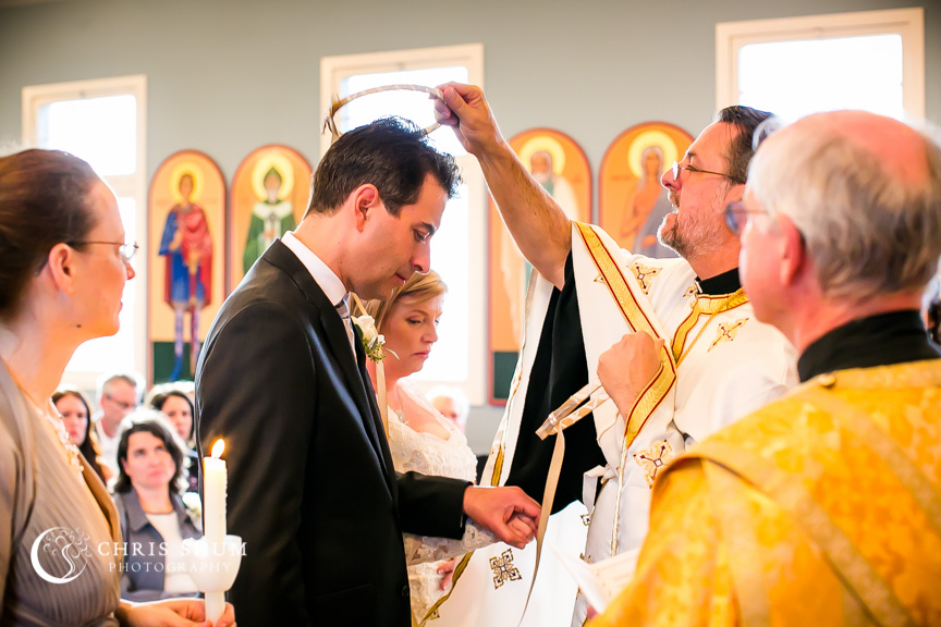 """San-Jose-Campbell-wedding-priest-performing-the-crowning-service"""