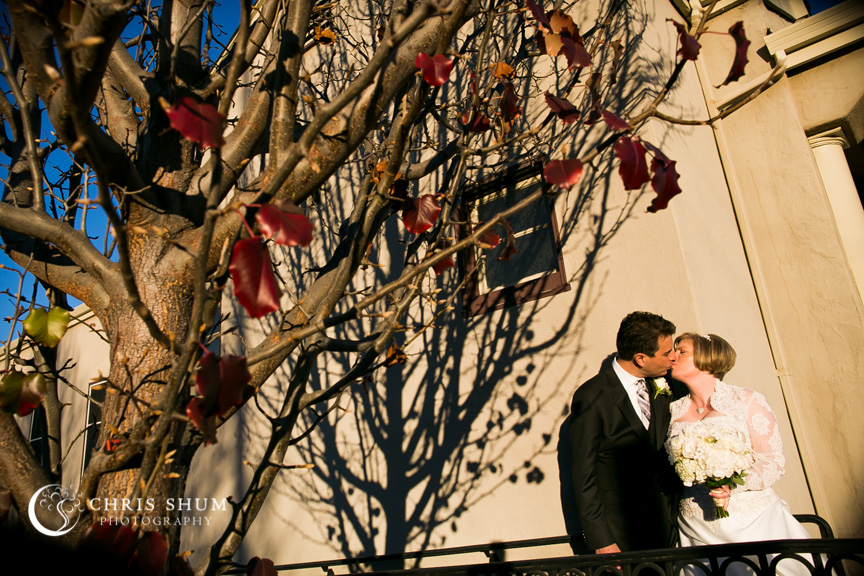 """San-Jose-Campbell-wedding-brid-groom-kiss-outside-church"""